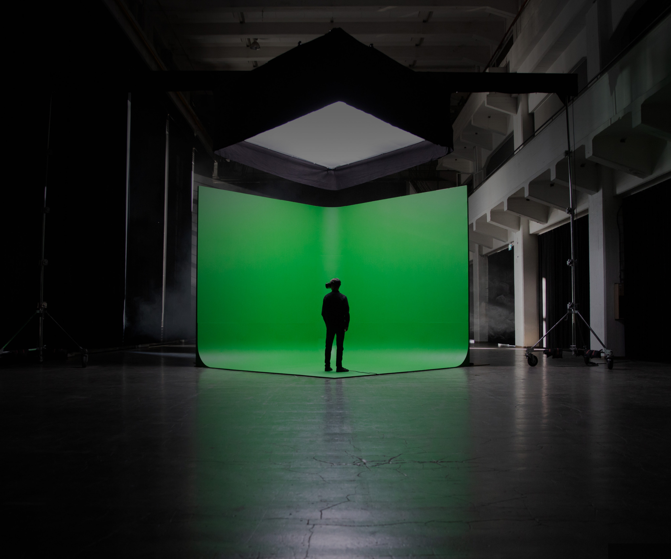 person standing in front of green screen wearing Varjo headset