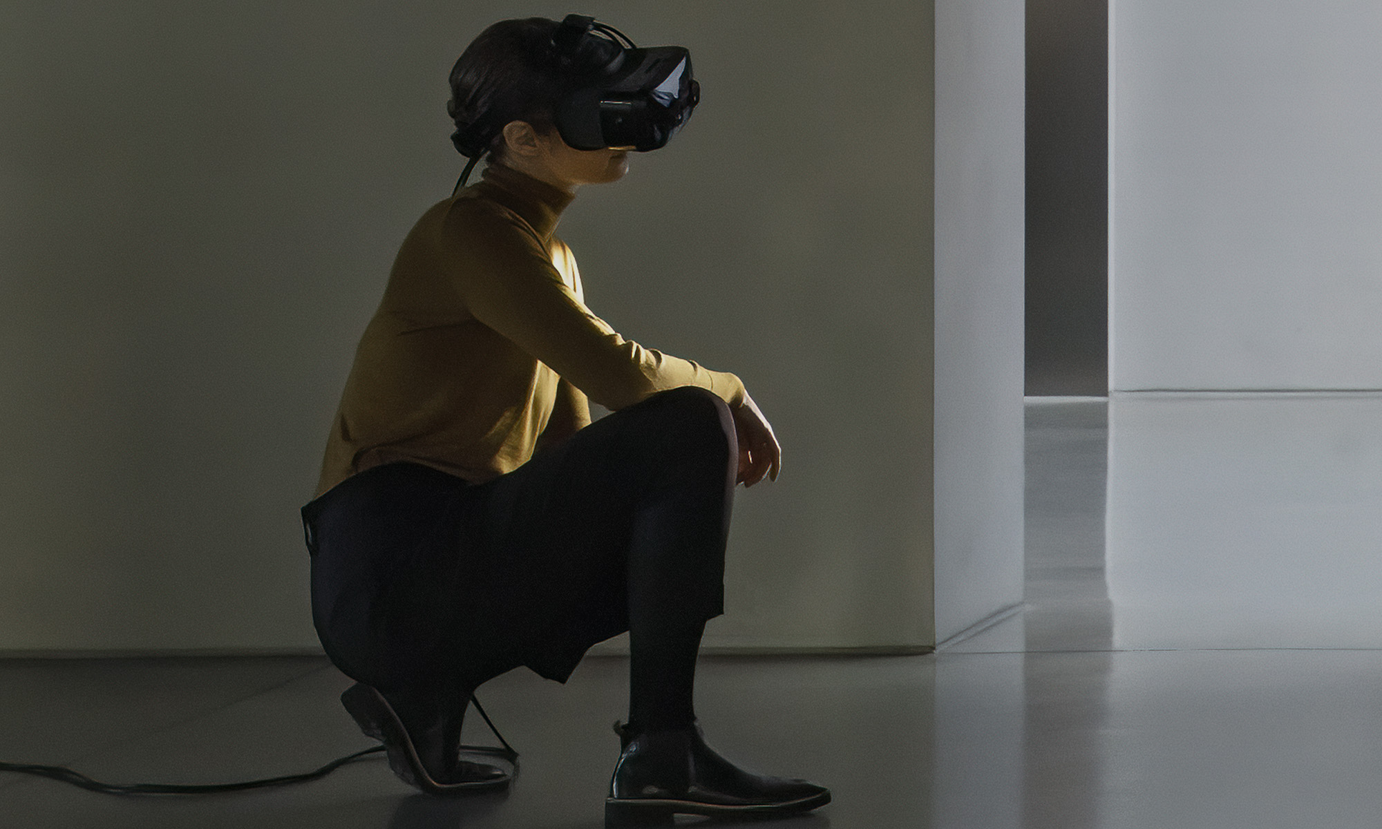 woman in brown shirt wearing Varjo mixed reality headset
